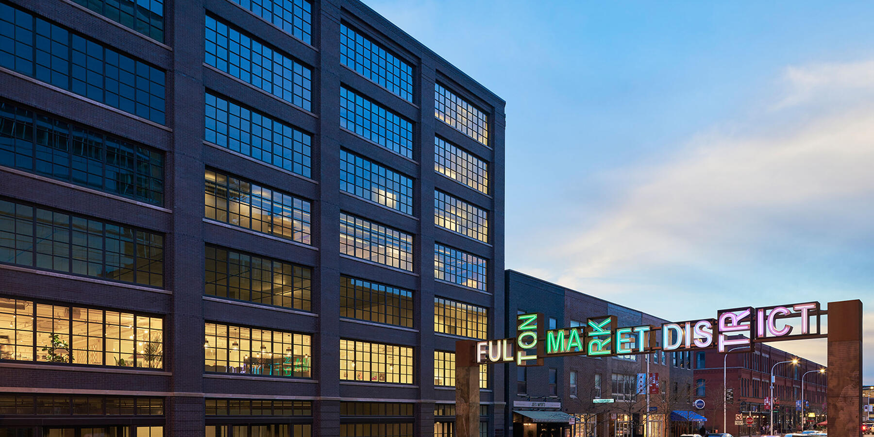 High End Office Construction Chicago - 811 W Fulton exterior view at night with Fulton Market sign