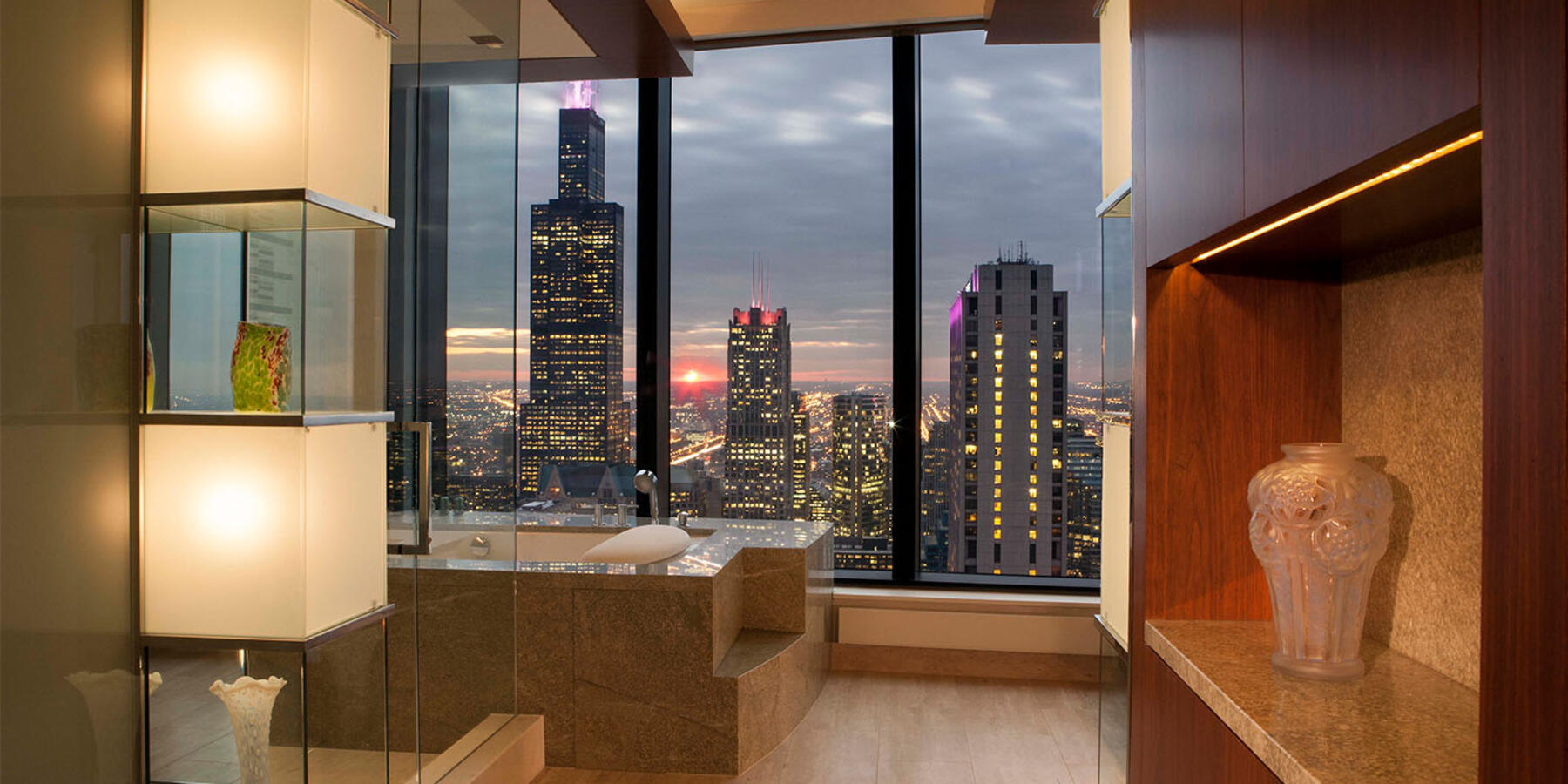 High End Home Contractors Chicago - The Legacy interior with skyline views at dusk