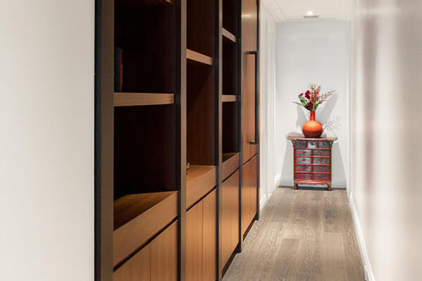 Luxury Residential Home Construction - Drake Tower Chicago hallway with built-in shelving
