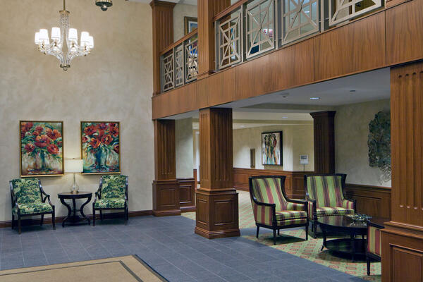 Senior Living Construction - Presbyterian Homes Lake Forest two-story atrium and seating area