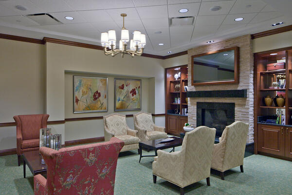 Senior Living Construction - Presbyterian Homes Lake Forest seating area with fireplace